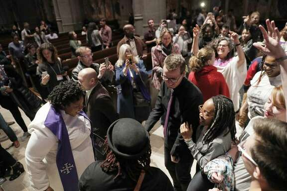 "The Rev. Yolanda Norton, of the San Francisco Theological Seminary gave a guest sermon on her current course ""Beyoncé and the Hebrew Bible"" dances with congregants at Grace Cathedral to celebrate the Beyonce Mass on Wednesday, April 25, 2017 in San Francisco, Calif."