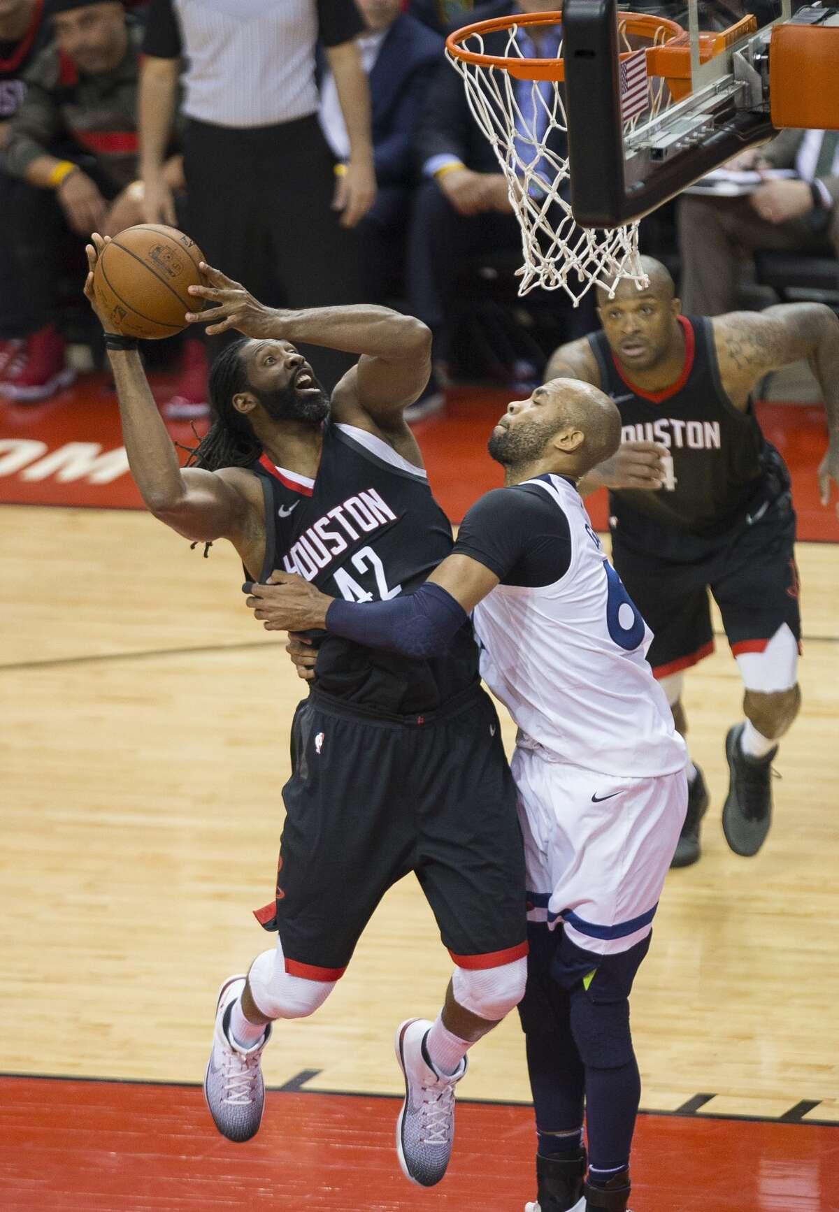 Houston Rockets center Nene (42) shoots over Minnesota Timberwolves forward Taj Gibson (67) during Game 5 of an NBA basketball first-round playoff series Wednesday, April 25, 2018, in Houston. (Mark Mulligan/Houston Chronicle via AP)