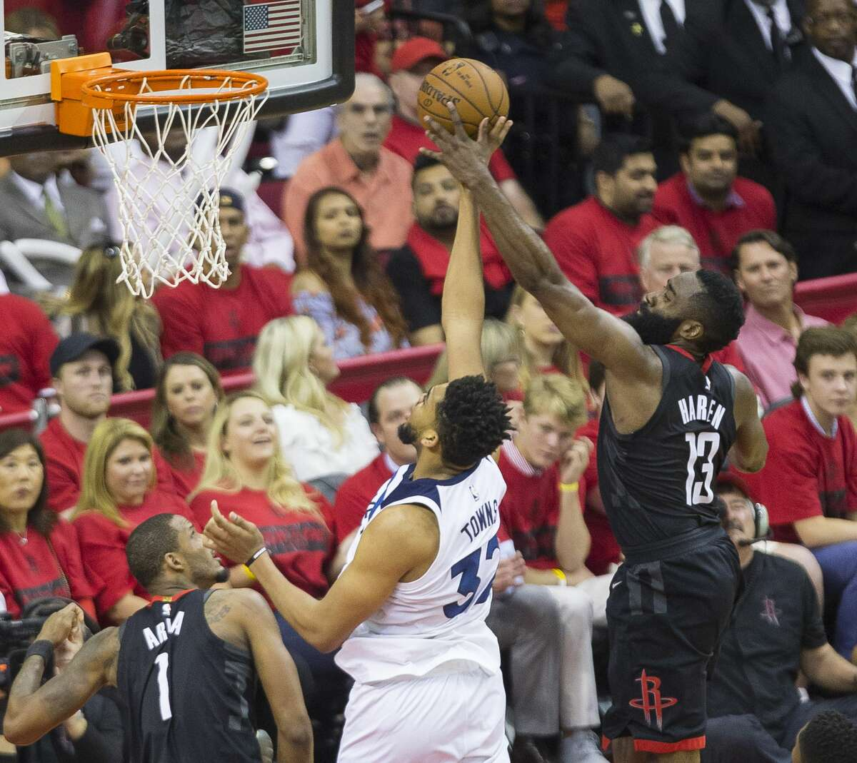 Houston Rockets guard James Harden (13) tries to block a Minnesota Timberwolves center Karl-Anthony Towns (32) during Game 5 of an NBA first round playoff series at Toyota Center, Wednesday, April 25, 2018, in Houston. ( Mark Mulligan / Houston Chronicle )