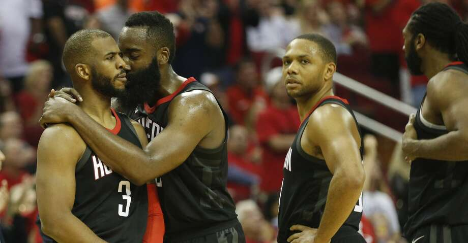 Houston Rockets guard Chris Paul (3) consoled by James Harden (13)  after being separated from Minnesota Timberwolves guard Jamal Crawford in the second half of Game 5 of a playoff NBA basketball game at Toyota Center, Wednesday, April 25, 2018, in Houston. ( Brett Coomer  / Houston Chronicle ) Photo: Brett Coomer/Houston Chronicle