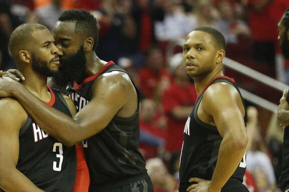 Houston Rockets guard Chris Paul (3) consoled by James Harden (13)  after being separated from Minnesota Timberwolves guard Jamal Crawford in the second half of Game 5 of a playoff NBA basketball game at Toyota Center, Wednesday, April 25, 2018, in Houston. ( Brett Coomer  / Houston Chronicle )