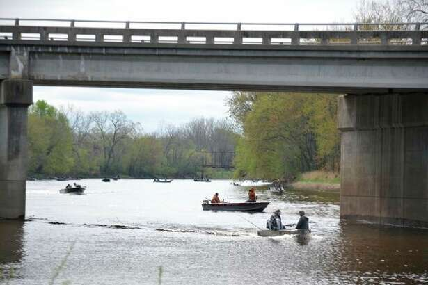 The Tittabawassee River gets busy when the Lower Peninsula inland waters walleye season opens on the last Saturday in April, which is April 28 this year.Pictured here isthe scene at last year's inland walleye opener, as seen from the Caldwell Boat Launch just upstream of the Poseyville Road bridge.(Steve Griffin file photo/Hearst Michigan)