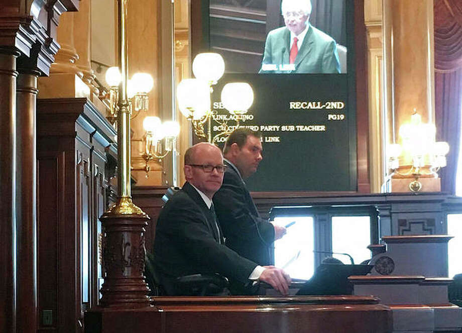 Senate President Pro Tempore Don Harmon (seated) presides over the Senate on Wednesday. Harmon is sponsor of legislation to require state licensing of firearms dealers, which was vetoed by Republican Gov. Bruce Rauner.