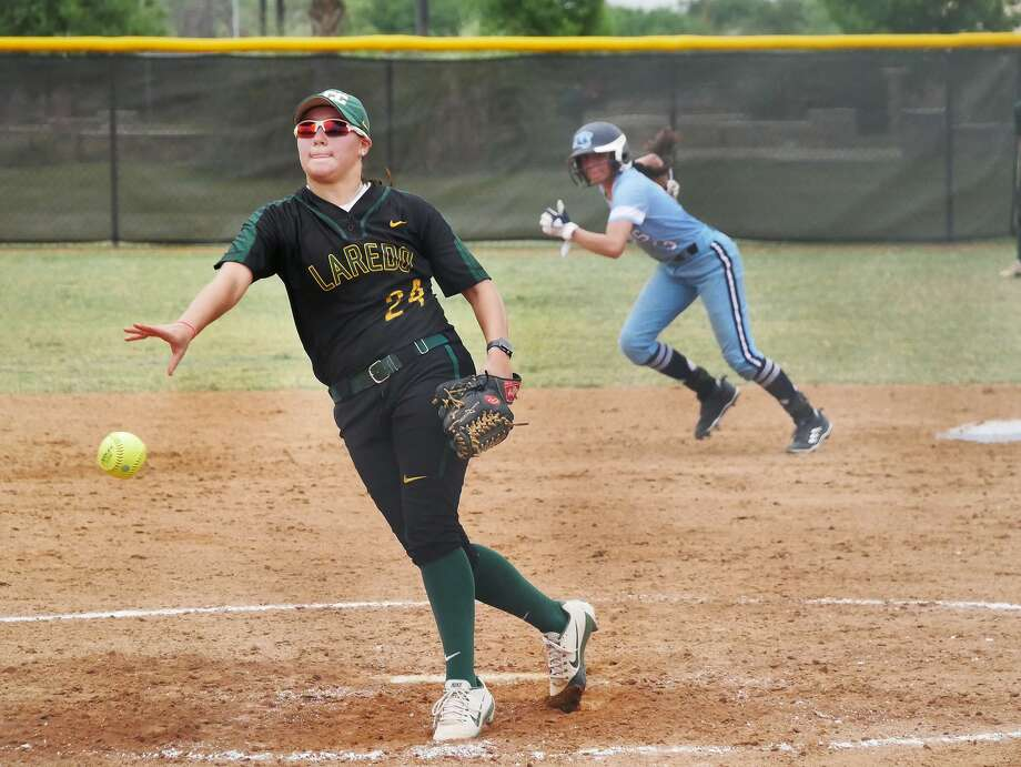Kayla Oliveira got the victory on the mound and scored the winning run in LCC's 4-3 walk-off win Wednesday over Coastal Bend College. Game 2 was tied at 5 when it was suspended due to rain. It will restart Thursday at 2 p.m. Photo: Cuate Santos /Laredo Morning Times / Laredo Morning Times