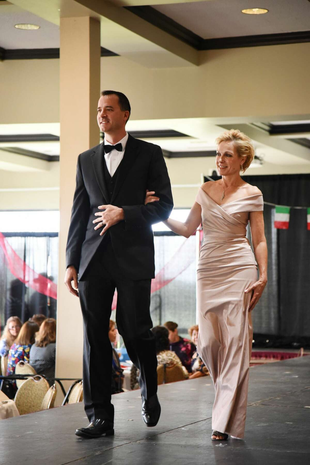 Participants walk, dance or sing along the runway for the fashion show put together by the Volunteer Services Council for the Border Region Behavioral Health Center, Wednesday, April 25, 2018.
