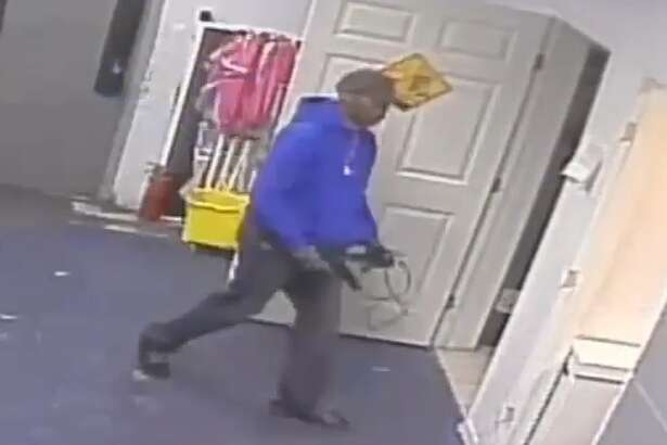 Houston police are searching for a suspect who robbed a Kingwood T-Mobile store at gunpoint on March 3, tying two employees with zip-ties while the third opened the safe.