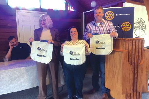 From left, Rachael Tompkins, Stephanie Malench and Mayor Hal Patton show off new reusable bags purchased by the city, and which will be given out to residents.