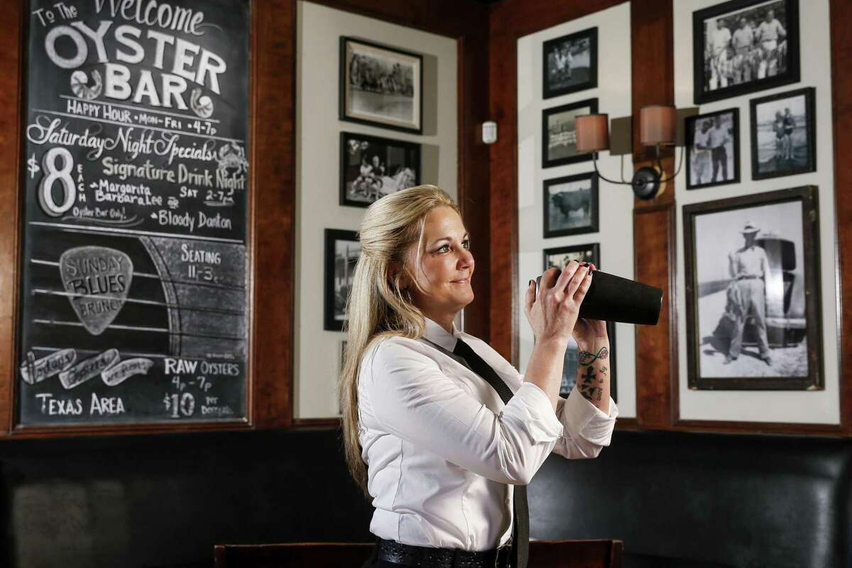 Danton's Gulf Coast Seafood and Steaks bartender Lisa Alexander shakes up one of her cocktail creations, the Puerto Rico, Tuesday, April 3, 2018 in Houston. (Michael Ciaglo / Houston Chronicle)