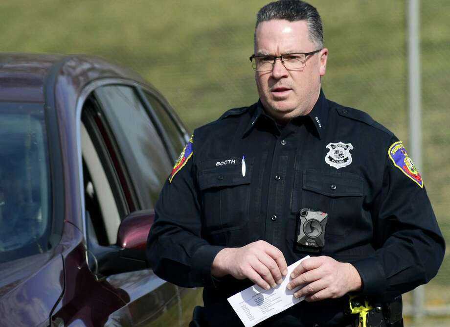 "Police officer Jeff Booth of the Stamford Police Department Traffic Unit, walks from his patrol car during a traffic stop on April 12, 2018 in Stamford, Connecticut. The Stamford Police Department will assign 160 patrol officers, sergeants and lieutenants body cameras, that will used by the officers ""at the inception of the interaction with the public in a law enforcement capacity."" Photo: Matthew Brown / Hearst Connecticut Media / Stamford Advocate"