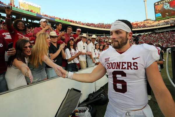DALLAS, TX - OCTOBER 14:  Baker Mayfield #6 of the Oklahoma Sooners high fives fans after the 29-24 win over the Texas Longhorns at Cotton Bowl on October 14, 2017 in Dallas, Texas.  (Photo by Richard W. Rodriguez/Getty Images)