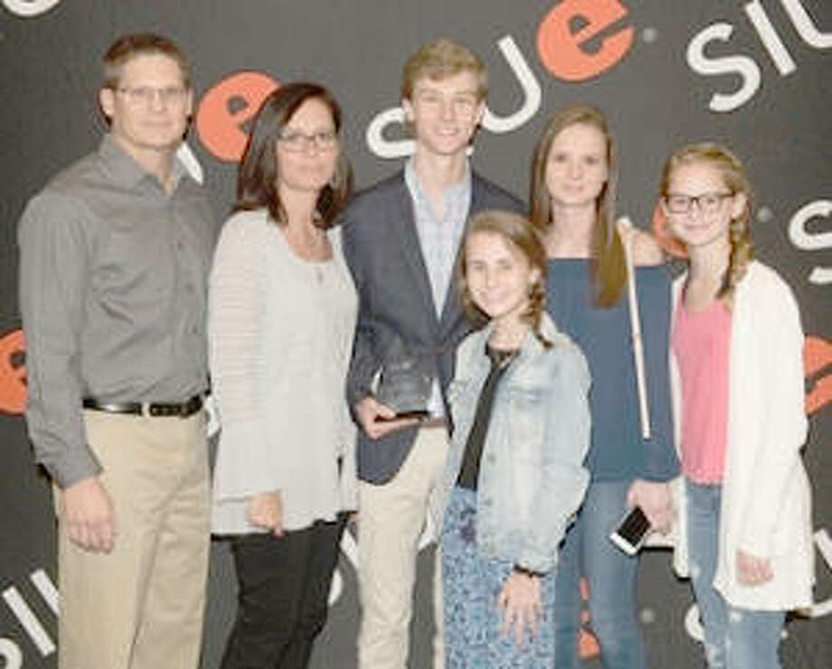 Sophomore Christopher Cole Egland (center) is supported by his family at SIUE's 28th Annual Kimmel Leadership Awards on Monday, April 23 in the Morris University Center Meridian Ballroom. Egland received the Kimmel Leadership Scholarship.