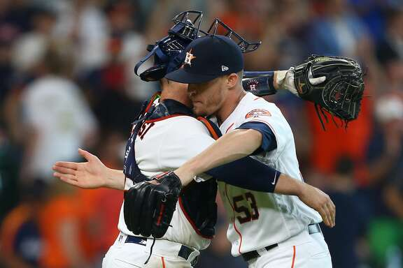 Houston Astros relief pitcher Ken Giles (53) and catcher Max Stassi (12) celebrate after defeating the Los Angeles Angels 5-2 during an MLB game at Minute Maid Park Wednesday, April 25, 2018, in Houston. ( Godofredo A. Vasquez / Houston Chronicle )