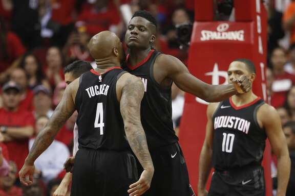 Houston Rockets center Clint Capela (15) reacts with Houston Rockets forward PJ Tucker (4) in the second half of Game 5 of a playoff NBA basketball game at Toyota Center, Wednesday, April 25, 2018, in Houston. ( Brett Coomer  / Houston Chronicle )