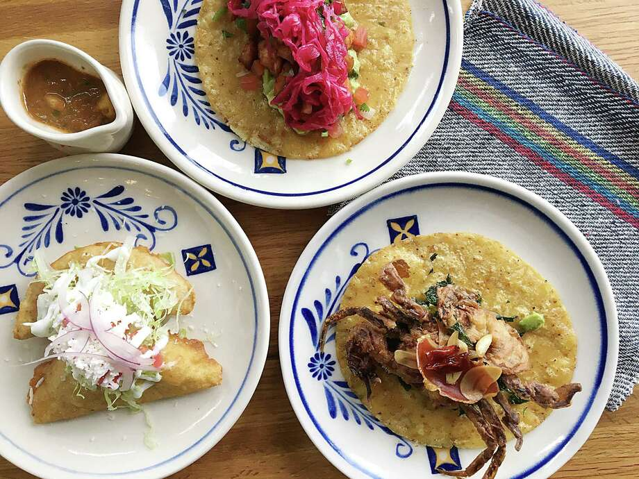 Fish empanadas, left, salmon carnitas taco and a soft-shell crab taco from Villa Rica. Photo: Mike Sutter /Staff File Photo