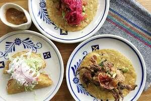 Fish empanadas, left, salmon carnitas taco and a soft-shell crab taco from Villa Rica.