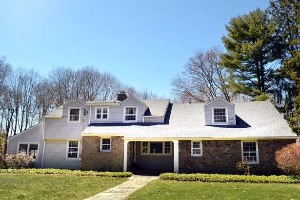 The Cape Cod house at 1265 Daniels Farm Road, built in 1944, is a bit unusual for capes of its era, with all four bedrooms upstairs and a first-floor laundry. The custom-built, 2,489-square-foot home has many of its original features, including hardwood floors and lots of storage space. It also has an unusual amount of open space for the area, sitting on 2.68 acres of property in what is typically a one-acre zone.