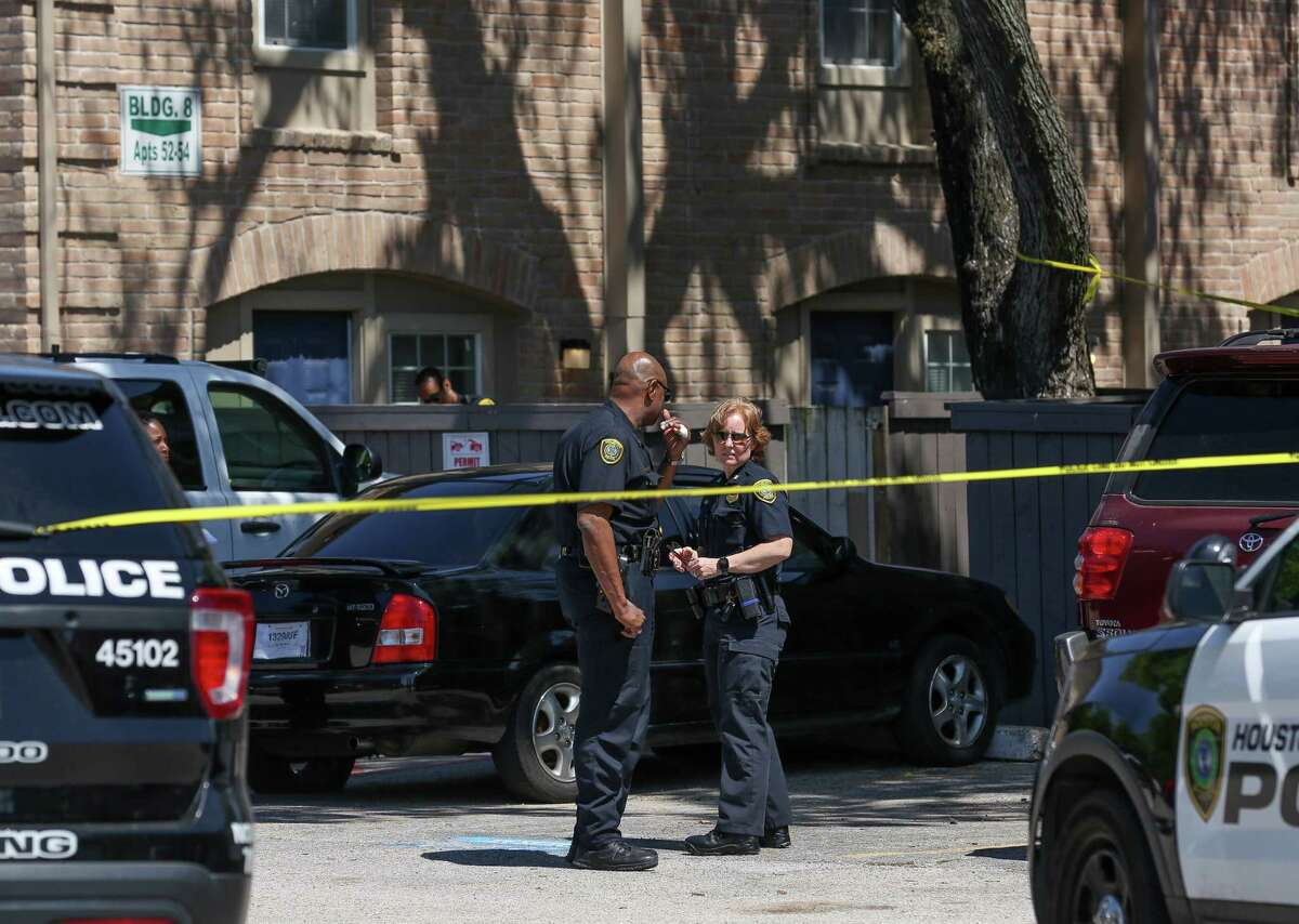 Houston Police officers investigate the scene of a shooting, where a woman died on the 11800 block of Chimney Rock Road Wednesday, April 25, 2018, in Houston.