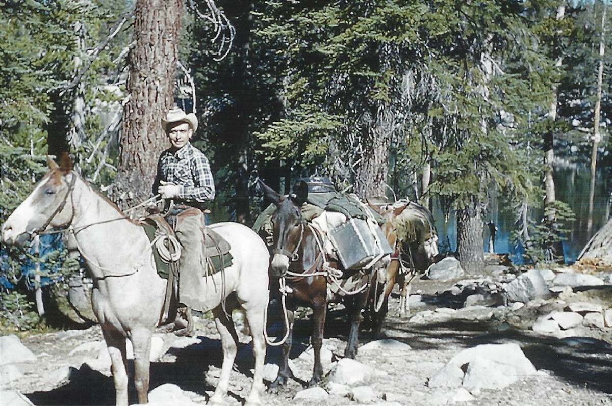 Pack leader Johnny Jones leads a mule train through Yosemite near Givens Lake in the 1950s.