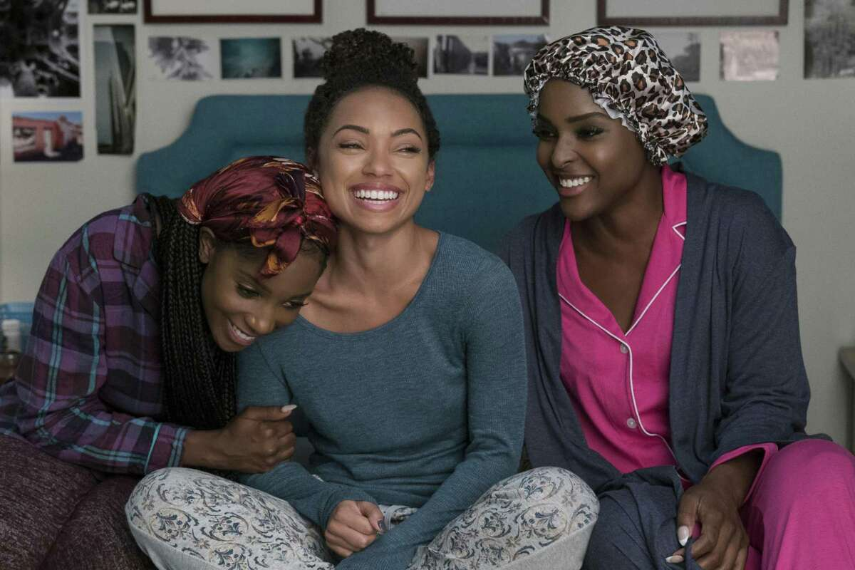 The central female characters - Sam (Logan Browning), center, Coco (Antoinette Robertson), right, and Joelle (Ashley Blaine Featherson) - in a bonding scene of the second season of