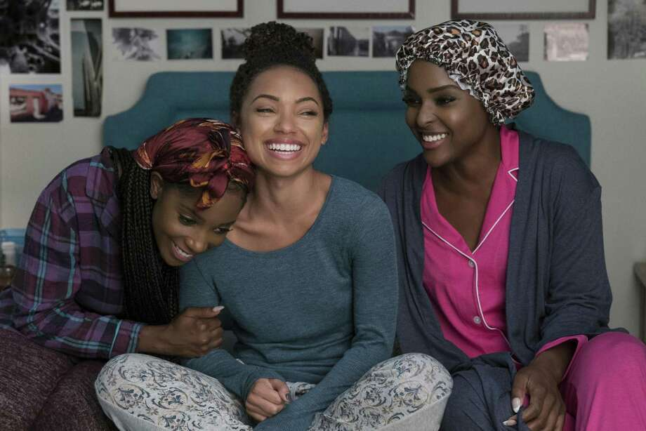 "The central female characters — Sam (Logan Browning), center, Coco (Antoinette Robertson), right, and Joelle (Ashley Blaine Featherson) — in a bonding scene of the second season of ""Dear White People,"" a racially charged, yet very funny, half-hour on Netflix. Photo: Saeed Adyani /Netflix / DWP-09679"