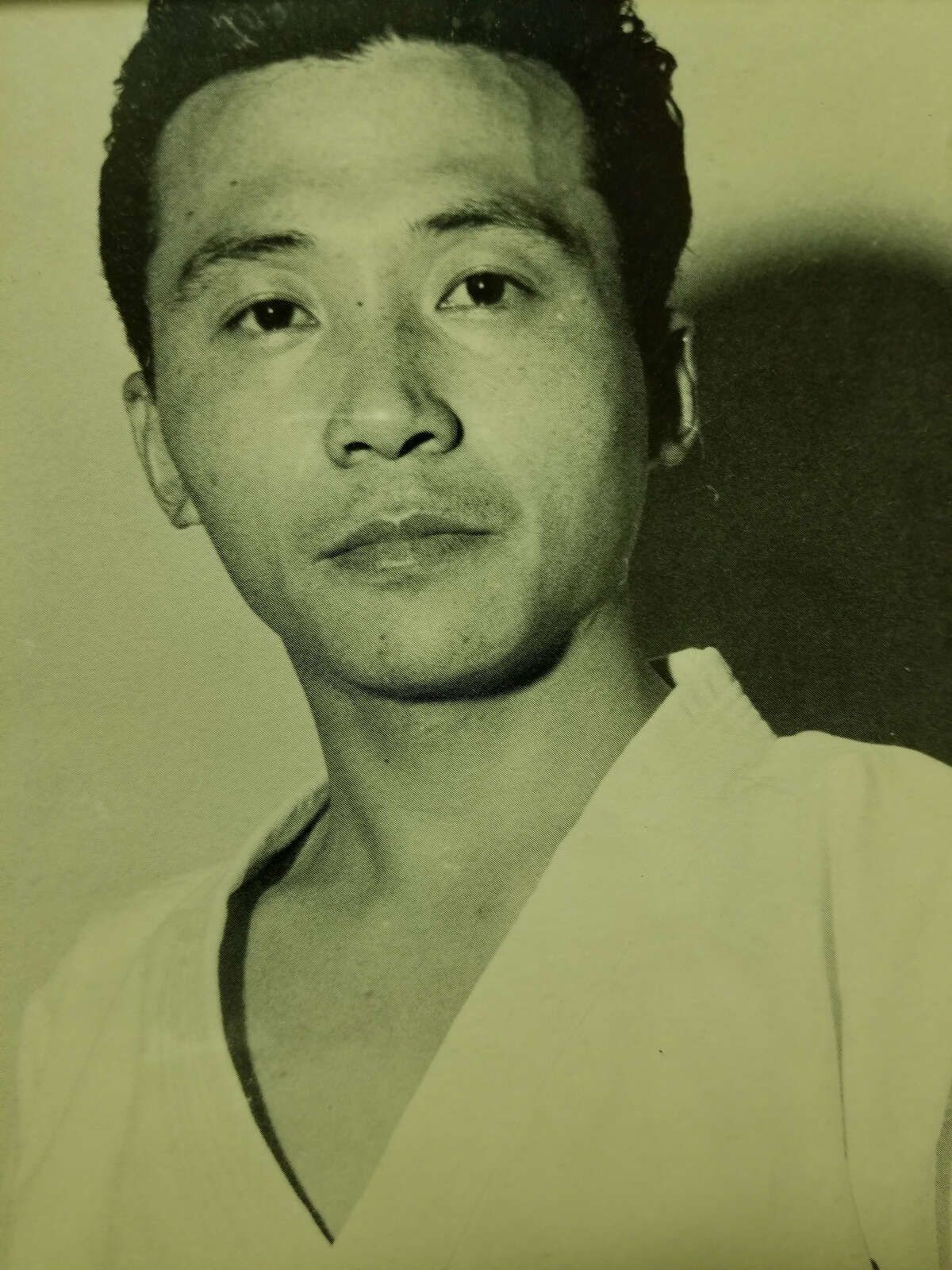 Kim Soo in his first photograph after immigrating to Texas from South Korea in 1968.