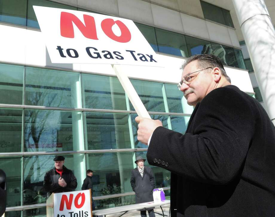 Public protest against tolls, a new gas tax and tire tax, held in front of the Stamford Goverment Center, Stamford, Conn., Saturday, Feb. 17, 2018. Roughly 75 people attended the protest that was accompanied by a caravan of trucks circling the center honking their horns in support of the protest. Gov. Dannel P. Malloy wants legislators to pass measures including electronic tolls, an increase in state gasoline taxes and a new tax on the sale of tires, to pay for Connecticut's transportation system that he says is facing a serious fuding crisis. Photo: Bob Luckey Jr. / Hearst Connecticut Media / Greenwich Time