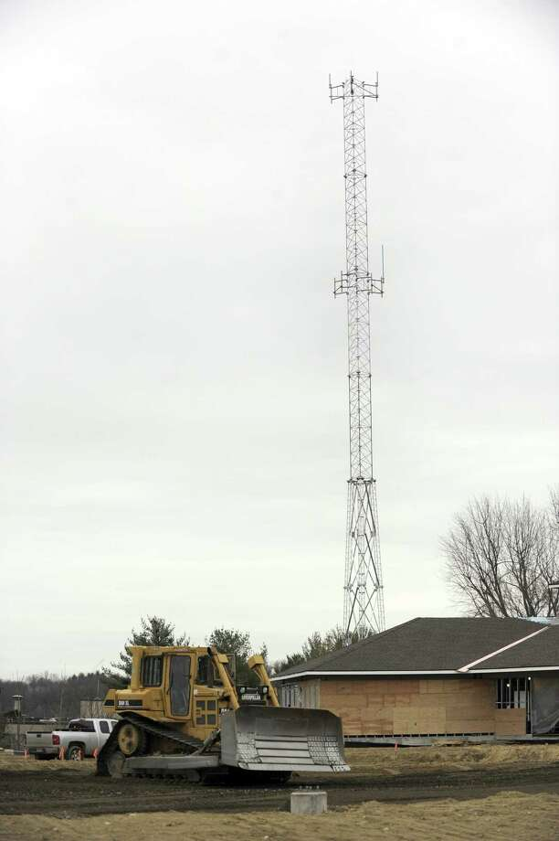 The communication tower can be seen near the new Bethel Police Station which is under construction Friday, Dec. 22, 2017. Crews are about halfway finished with the new Bethel police station. The 26,000-square-foot station is budgeted at $13.5 million. Photo: Carol Kaliff / Hearst Connecticut Media / The News-Times