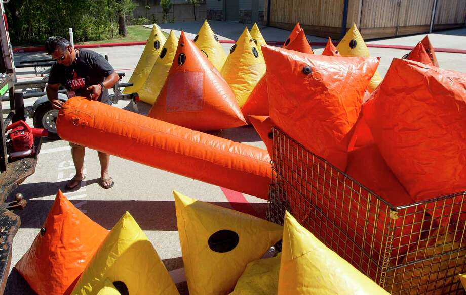 Ironman staff members work to prepare buoys for the swimming portion of Saturday's triathlon at Northshore Park, Thursday, April 26, 2018, in The Woodlands. Photo: Jason Fochtman, Houston Chronicle / © 2018 Houston Chronicle