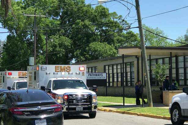 Ambulances respond to a reported pepper spray incident at Pathways Learning Center Thursday, April 26, 2018. 