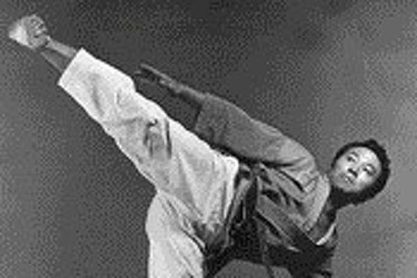 Kim Soo striking a power kick pose in 1970.