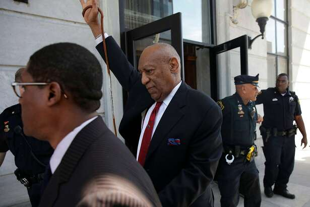 Actor and comedian Bill Cosby (C) comes out of the Courthouse after the verdict in the retrial of his sexual assault case at the Montgomery County Courthouse in Norristown, Pennsylvania on April 26, 2018. Disgraced television icon Bill Cosby was convicted Thursday of sexual assault by a US jury -- losing a years-long legal battle that was made tougher at retrial as the first celebrity trial of the #MeToo era. / AFP PHOTO / Dominick ReuterDOMINICK REUTER/AFP/Getty Images