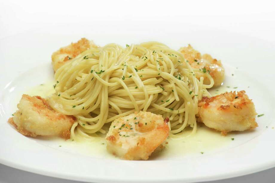 Paesanos RiverWalk: Christmas Eve and Christmas Day. 111 W. Crockett St., 210-227-2782, paesanosriverwalk.com, will offer a dinner special, $50, for 11 a.m.-10 p.m. It includes pesto-marinated seabass stacked on a baked eggplant and sauteed spinach served with lemon butter garlic and a blood orange reduction with two Shrimp Paesano paired with a glass of Quilt Chardonnay. Photo: Paesanos / ALBERTOVAZQUEZPHOTOGRAPHY