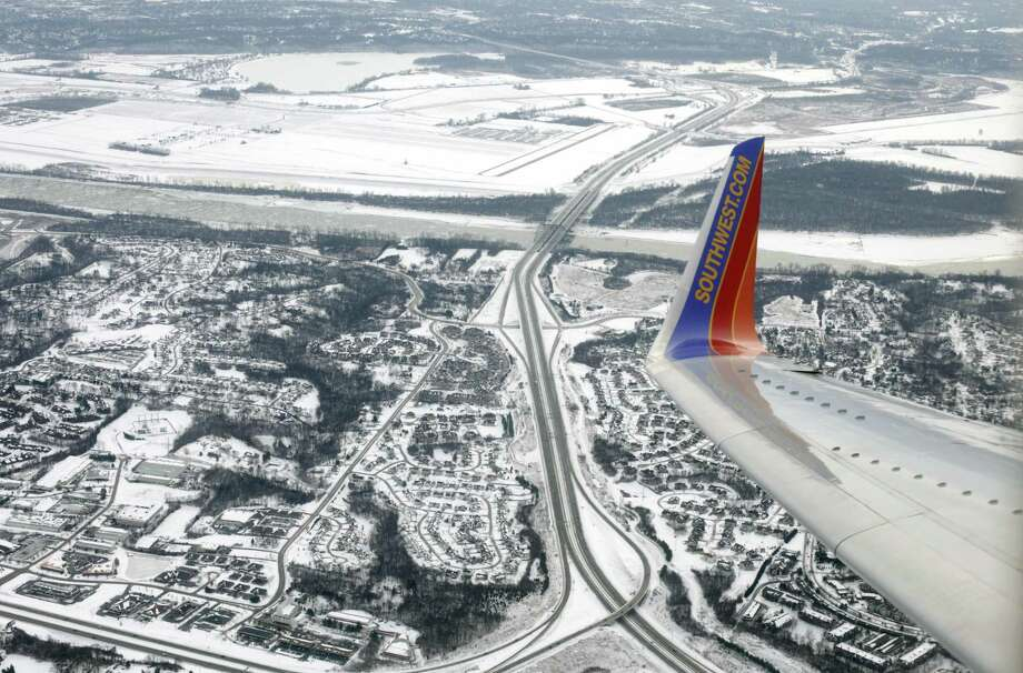 In this Jan. 8, 2014, photo, a Southwest Airlines plane approaches LambertSt. Louis International Airport in St. Louis. Southwest Airlines says bookings are down since the fatal accident on one of its planes last week. Photo: Kiichiro Sato /Associated Press / Copyright 2018 The Associated Press. All rights reserved.