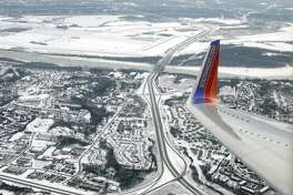 In this Jan. 8, 2014, photo, a Southwest Airlines plane approaches LambertSt. Louis International Airport in St. Louis. Southwest Airlines says bookings are down since the fatal accident on one of its planes last week.