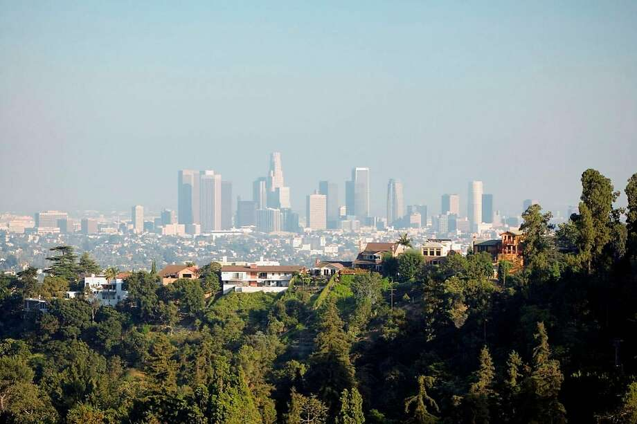 Tougher air quality standards, along with cleaner-burning engines on new vehicles today, have dramatically cut air pollution in once-famously smoggy Los Angeles since the 1970s. Photo: Photodisc / Thinkstock