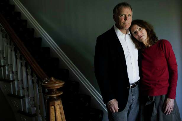 """Fred and Cindy Warmbier in their home in Wyoming, Ohio, near Cincinnati, on Wednesday. Their son, U-Va. student Otto Warmbier, is incarcerated in North Korea after having been convicted of """"hostile acts against the state"""" and sentenced to 15 years' hard labor."""