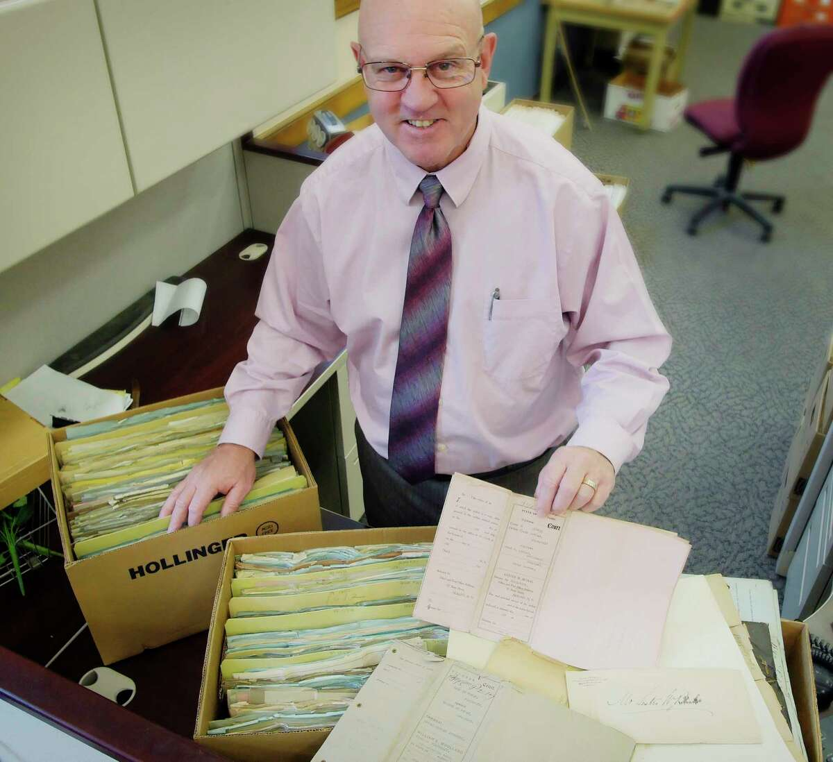 Albany County Clerk Bruce Hidley with old divorce records.(Paul Buckowski / Times Union)