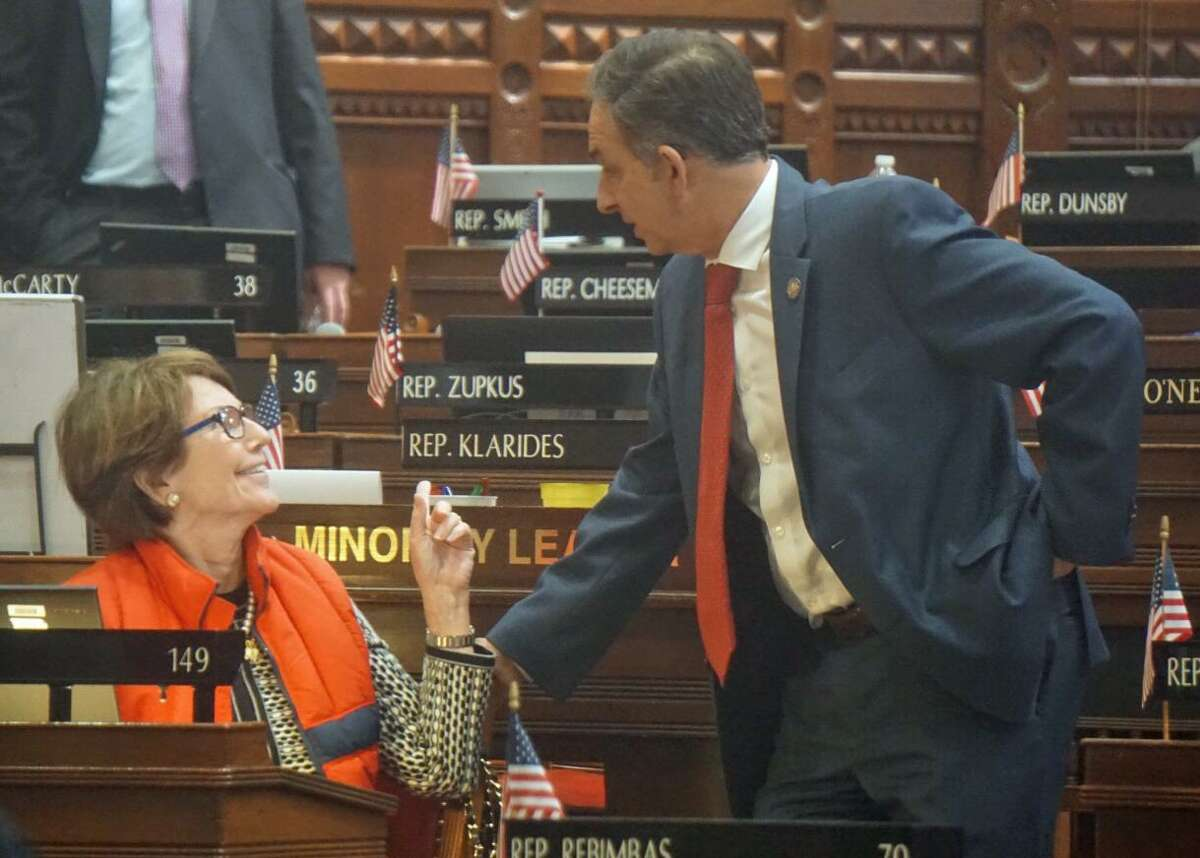 State Rep. Livvy Floren of Greenwich (left) was the only Republican to vote with Democrats to approve Connecticut joining the National Popular Vote Interstate Compact. She chatted with (right) Rep. Dave Yaccarino, R-North Haven, at the Capitol in Hartford, Conn. on Thursday April 26, 2018.