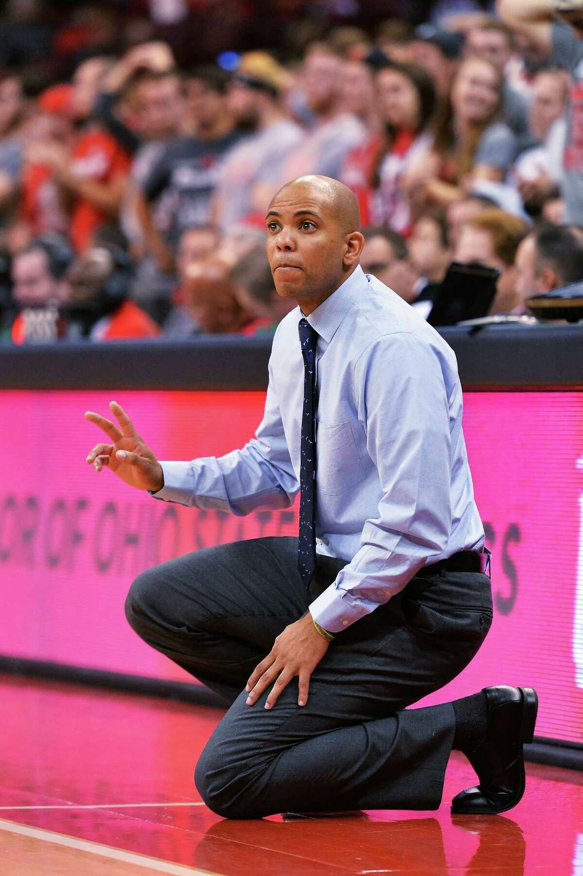 COLUMBUS, OH - NOVEMBER 15: Head Coach Jamion Christian of the Mount St. Mary's Mountaineers watches his team play against the Ohio State Buckeyes in the first half on November 15, 2015 at Value City Arena in Columbus, Ohio. Ohio State defeated Mount St. Mary's 76-54. (Photo by Jamie Sabau/Getty Images) ORG XMIT: 588957669