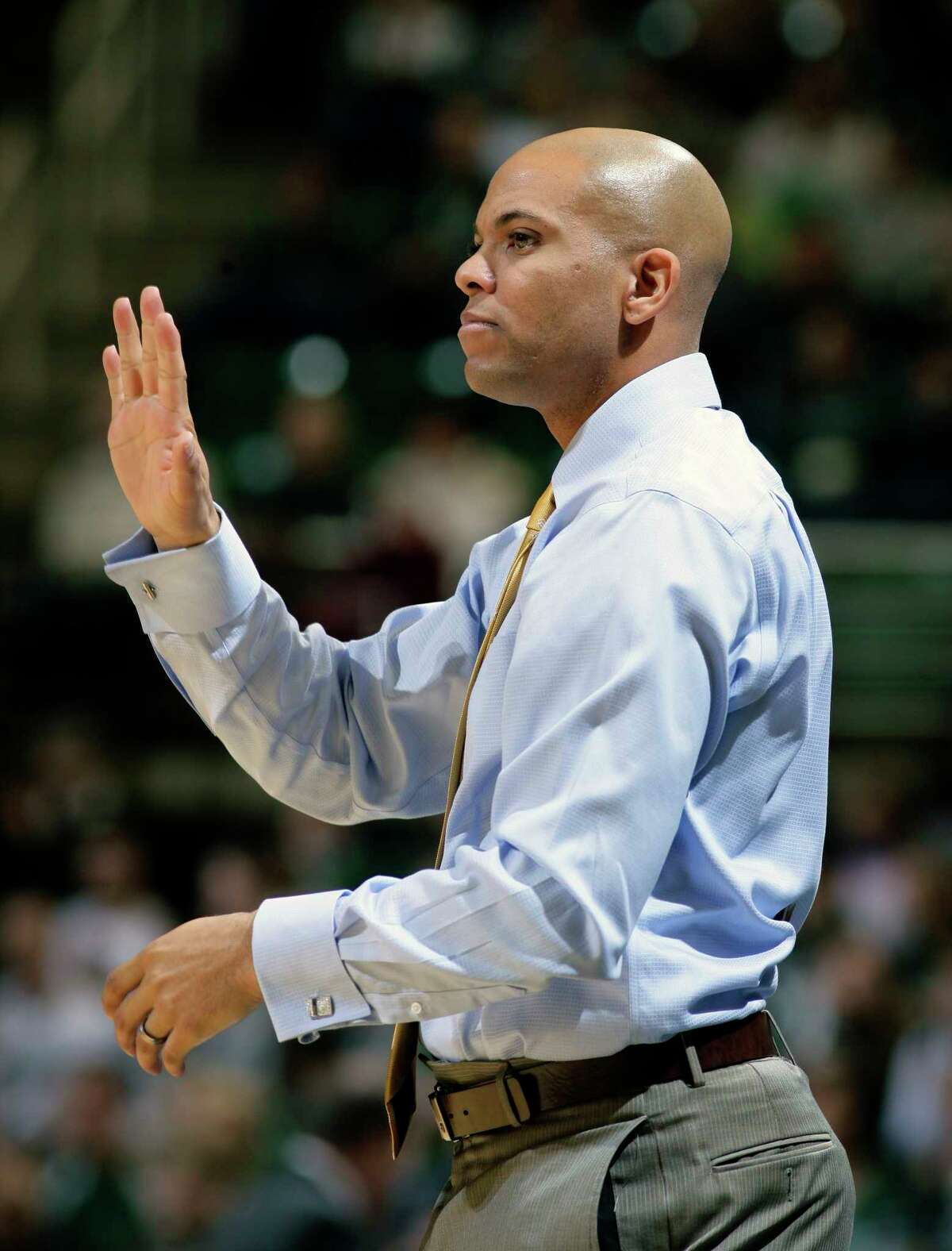 Mount St. Mary's coach Jamion Christian gives instructions to his team during the first half of an NCAA college basketball game against Michigan State, Friday, Nov. 29, 2013, in East Lansing, Mich. Michigan State won 98-65. (AP Photo/Al Goldis) ORG XMIT: ELJ107