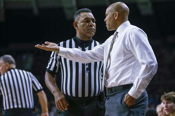 SOUTH BEND, IN - NOVEMBER 13: Head coach Jamion Christian of the Mount St. Mary's Mountaineers talks to an official about a call during the game against the Notre Dame Fighting Irish at Purcell Pavilion on November 13, 2017 in South Bend, Indiana. (Photo by Michael Hickey/Getty Images) ORG XMIT: 775064302