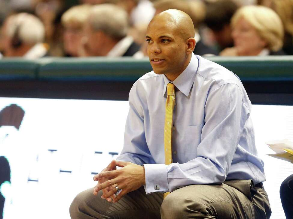 EAST LANSING, MI - NOVEMBER 29: Head coach Jamion Christian of the Mount St. Mary's Mountaineers look on during the second half while playing the Michigan State Spartans at the Jack T. Breslin Student Events Center on November 29, 2013 in East Lansing, Michigan. Michigan State won the game 98-65. (Photo by Gregory Shamus/Getty Images) ORG XMIT: 185392817