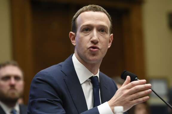 """(FILES) In this file photo taken on April 11, 2018 Facebook CEO and founder Mark Zuckerberg testifies during a US House Committee on Energy and Commerce hearing about Facebook on Capitol Hill in Washington, DC. Facebook announced April 18, 2018 it would begin rolling out changes to how it handles private data this week to comply with forthcoming EU rules, with European residents seeing the measures first. The social network, which has been rocked by disclosures about the hijacking of personal data on tens of millions of its users, said it will start implementing """"new privacy experiences"""" to comply with the EU's General Data Protection Regulation (GDPR) which become effective May 25.  / AFP PHOTO / SAUL LOEBSAUL LOEB/AFP/Getty Images"""