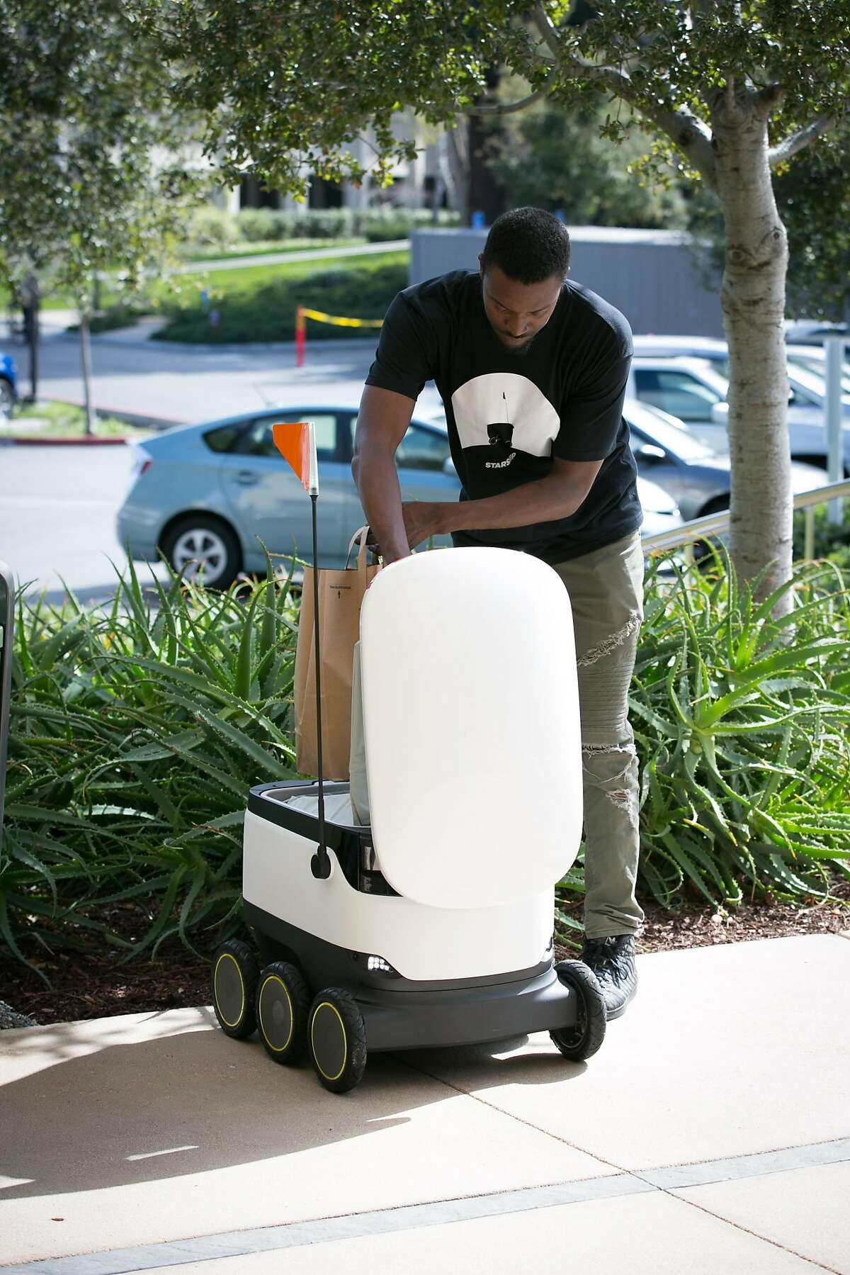 Starship Technologies is offering up its cooler-sized delivery robots to ferry food from cafeterias and restaurants on corporate and college campuses. It's been testing them at Intuit's Mountain View campus.