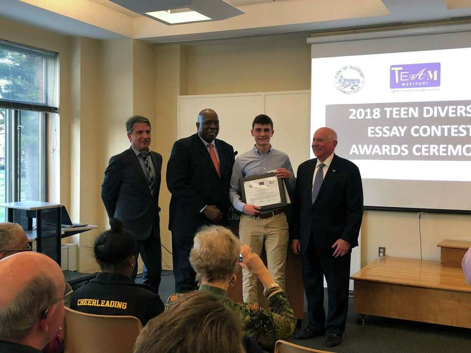 Staples High School senior Henry Cater, winner of TEAM Westport's 2018 Teen Diversity Essay Contest, with Westport Library Executive Director William Harmer, TEAM Westport Chairman Harold Bailey and First Selectman Jim Marpe. Photo: Contributed Photo / Westport News contributed