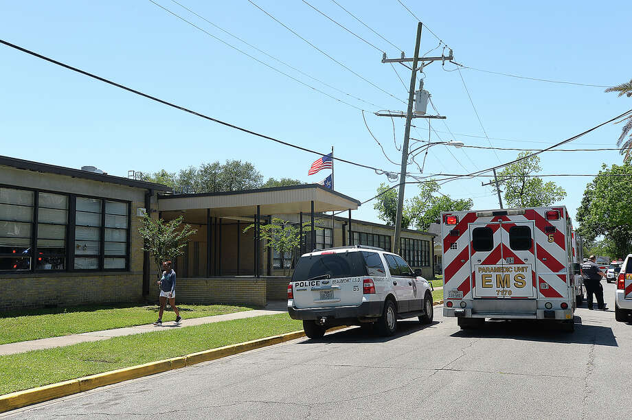 EMS, BISD police and Beaumont police respond to an incident at Pathways Learning Center. Multiple students were pepper sprayed after a fight broke out, including several who were not involved in the incident.  Photo taken Thursday, April 26, 2018 Kim Brent/The Enterprise Photo: Kim Brent/Beaumont Enterprise