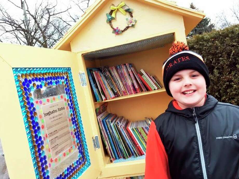 Jack Booms, 8, of Harbor Beach, is pictured in front of The Imagination Station. (Courtesy Photo)