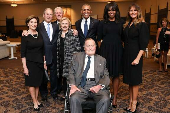 On Sunday, former President George H.W. Bush's office released a photo of first lady Melania Trump standing next to Michelle Obama, Barack Obama, Hillary Clinton, Bill Clinton, George W. Bush and Laura Bush, who all appear in front of George H.W. Bush. Conspicuously absent: Donald Trump.