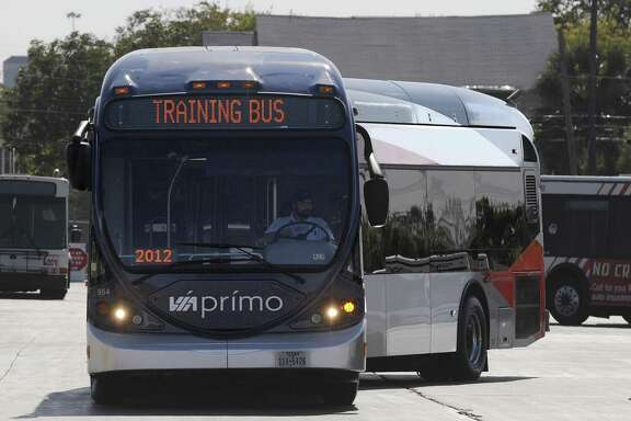 A VIA Primo articulated bus circles a parking area as drivers train on Nov. 20, 2012. Building more rapid transit in San Antonio will not likely get people out of their cars.
