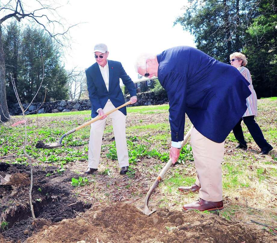 Greenwich resident Peter Malkin, left, and Greenwich Selectman John Toner, foreground right, helped to plant an apple tree during the dedication of the Greenwich Tree Conservancy Heirloom Apple Orchard at the Malkin Preserve in Greenwich, Conn., Thursday, April 26, 2018. The Malkin family donated the land for the orchard that is now open to the public and is located on Pheasant Lane. The ceremony was part of an Arbor Day celebration that recognized Greenwich as a Tree City USA and designated the town as a Level II national Arboretum. The heirloom apple orchard was planted in partnership with the Greenwich Land Trust. Photo: Bob Luckey Jr. / Hearst Connecticut Media / Greenwich Time